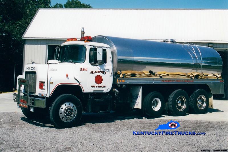 REASSIGNED <br /> Flaherty Tanker 584<br /> 1986 Mack DM/Bluegrass 500/4400<br /> Kent Parrish photo