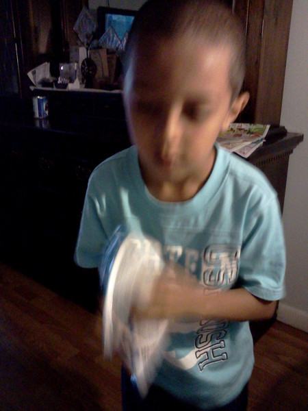 My 7 yr.old grandson shaking the ice pack for arm during surgery... He really took care of his gammy...