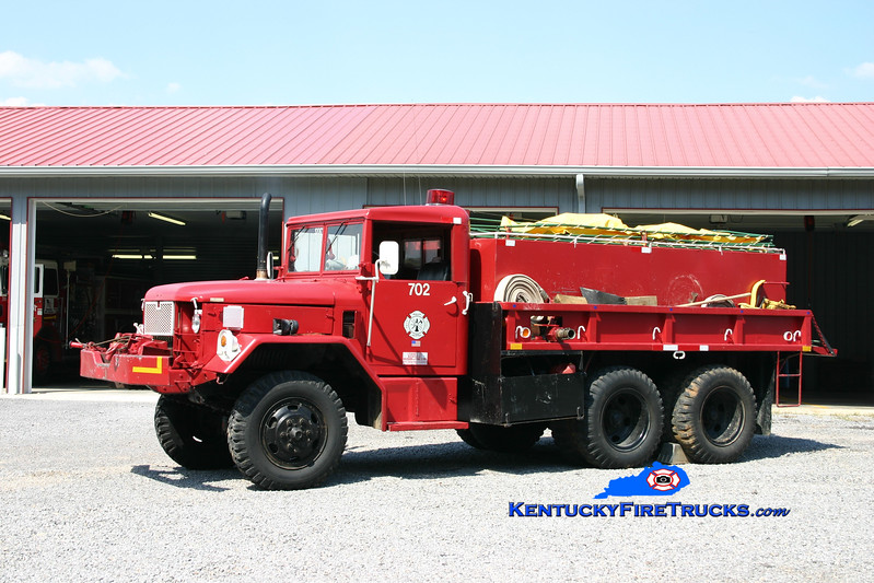 <center> RETIRED <br> Mud Lick  Tanker 702 <br> 1970 AM General M35/Local 150/1000 <br> Kent Parrish photo </center>