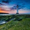 Setting Over the Lighthouse