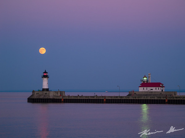 Moonrise at twilight over the Duluth Ship Canal
