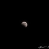 The first half of a total lunar eclipse on the Winter Solstice