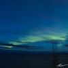 The aurora show begins to fade as sunrise draws near