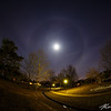 Full moon halo across the early spring night landscape