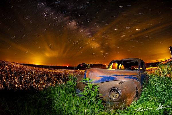 A long abandoned car watches over the slient Iowa landscape