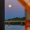 Moonrise through a bridge in Des Moines.