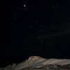The eclipsed moon, Orion, and Flattop Mountain on the Winter Solstice