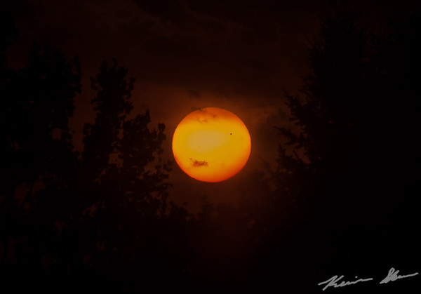 The planet Venus transits across the sun (right side) during the late afternoon in a once in a lifetime showing