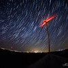 Stars race behind a wind turbine in central Iowa