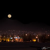Supermoon rise over the Chugach Mountains and Anchorage