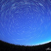 Star trails as the sun rises with the remnants of the Perseids meteor shower streaking through