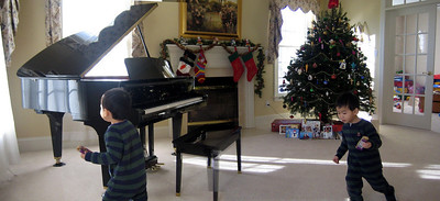 20051220-100613 Brandon Christmas Multiplicity  Errors: piano leg overlapping problem due to pano stiching.  This picture was done in 2005 and was created with a very different method than the others. It was a stiched-panoramic shot, and I had Brandon run from the first frame to the second as I took the 2 parts of the pano.