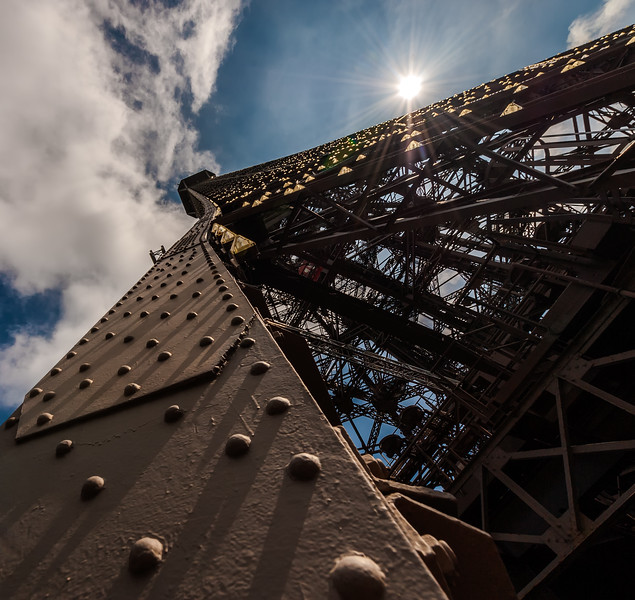 On a glourious sunny day I ventured up the Eiffel Tower in Paris. On the way down from the top I stopped to take some photos and found this interesting angle.
