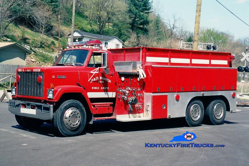 <center> RETIRED <br> Jakes Branch  Tanker 150 <br> 1986 GMC/Grootens 1000/3000 <br> Greg Stapleton photo <br> </center>