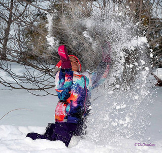 """LET IT ..LET IT SNOW...LET IT SNOW!                       My grand daughter playing in the snow the day after the blizzard """"Hercules"""""""".."""