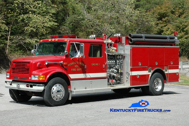<center> NOW WITH ELKHORN CITY <br> Ferrells Creek  Engine 1  <br> 1994 International 4900/Pierce 1250/1200 <br> Greg Stapleton photo </center>