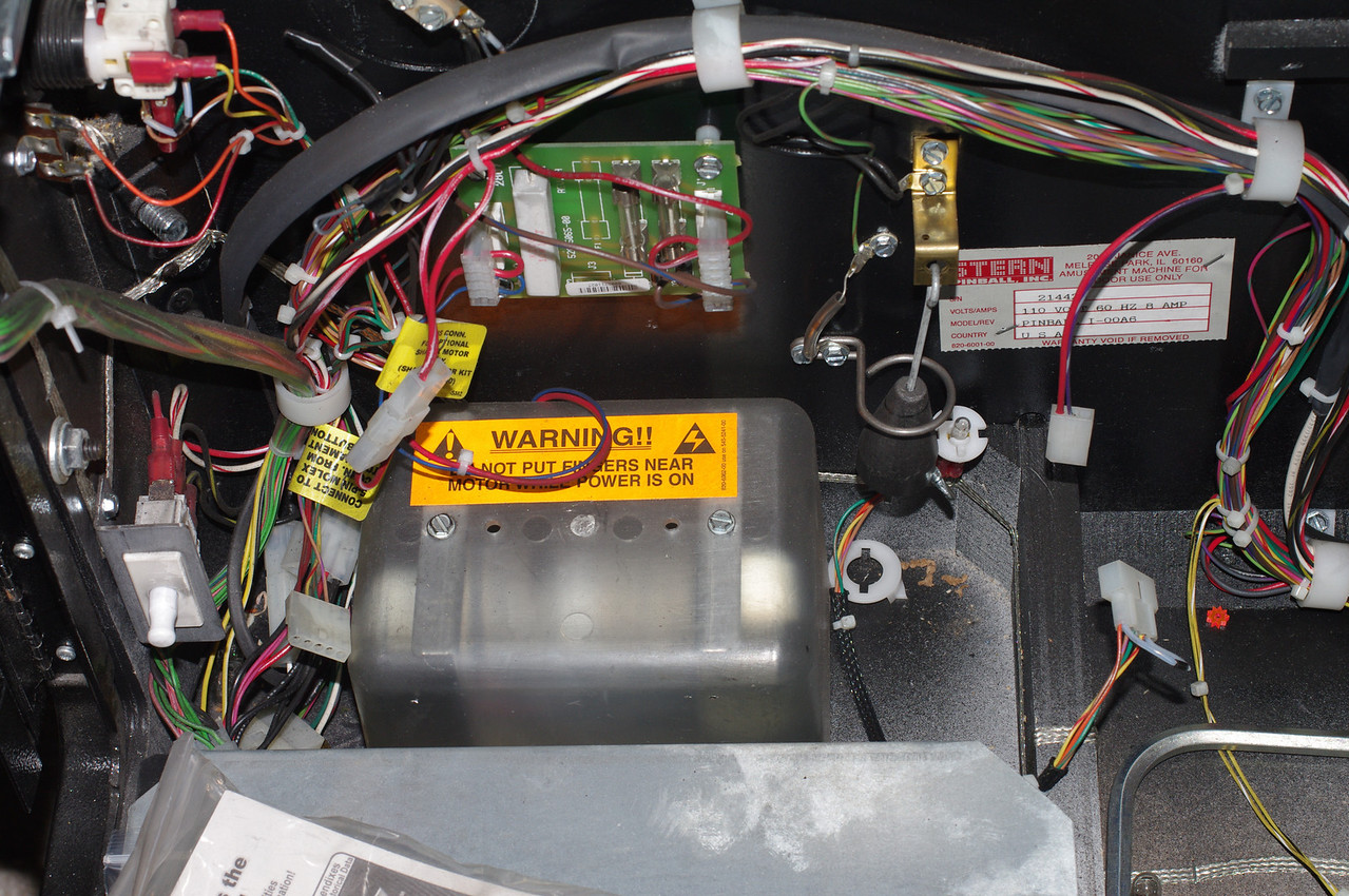 Here's a Stern shaker motor installed in a Spider-Man. This is where will install our motor.