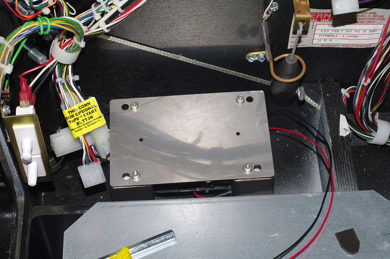First positioning. Just make sure that the power wires are on the cabinet side of the motor.Your goal is to get the motor positioned square in the machine, with some clearance from the sides.