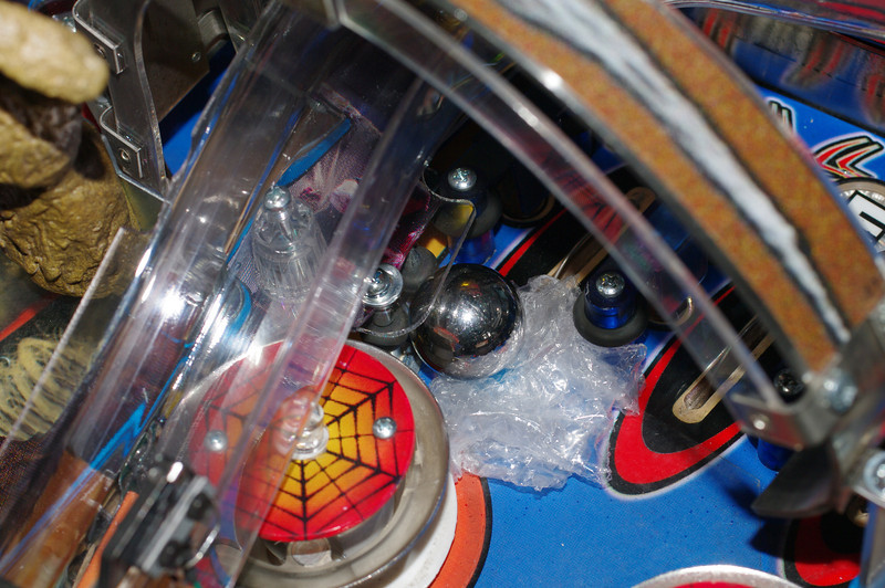 Here's the installed protector, over a broken plastic, with a ball against it. The ball can't get to the edge of the protected plastic when flying, and the bumpers keep it off when low. Bottom line, the ball can never touch the plastic.