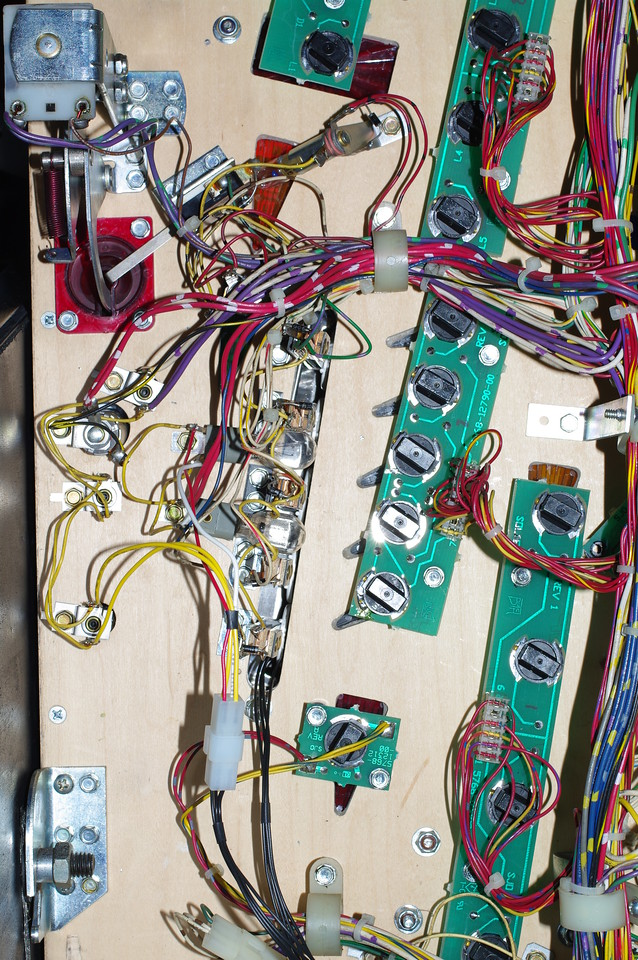 Here's the installation. You'll need to cut the wires on the harness to keep things tidy.<br /> <br /> 1) The two yellow wires go to the yellow wires on the lower GI connector, on the left hand side of the screen. They can go either way around.<br /> <br /> 2) The red and white wires connect to the two flashers underneath the target bank. The flashers are connected together with yellow wires. Solder to the extension flasher.<br /> The red wire goes to the flasher terminal that connects to the two red wires. This is the 20V supply.<br /> The white wire goes to the terminal that connects to the blue-brown wire. <br /> <br /> 3) When you are done, feed the black cable through the hole at the end of the target bank, and assemble the cable and ship on the top side. Use the cable ties to dress the wiring.