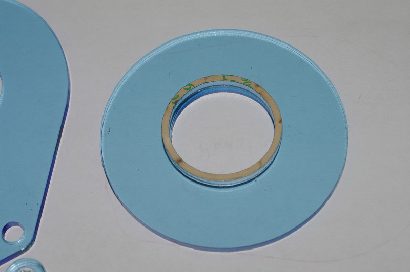 Large adhesive ring on an undrilled large disc.