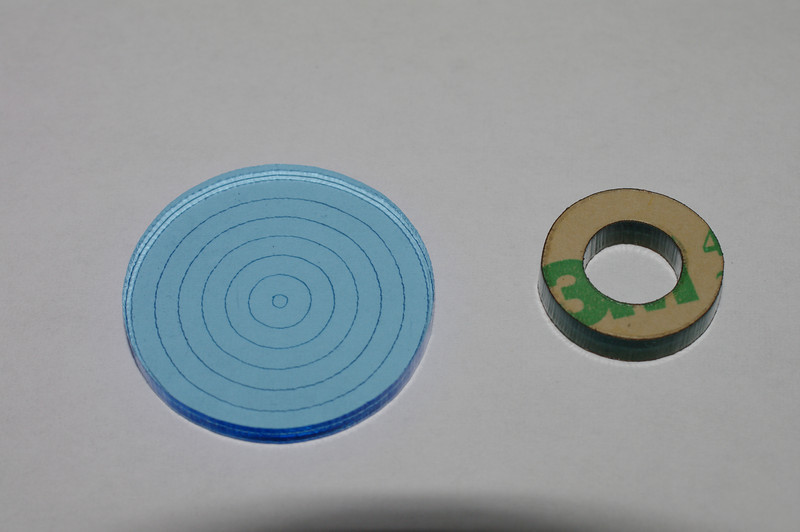 Start with a small top ring, and the smallest adhesive disk.