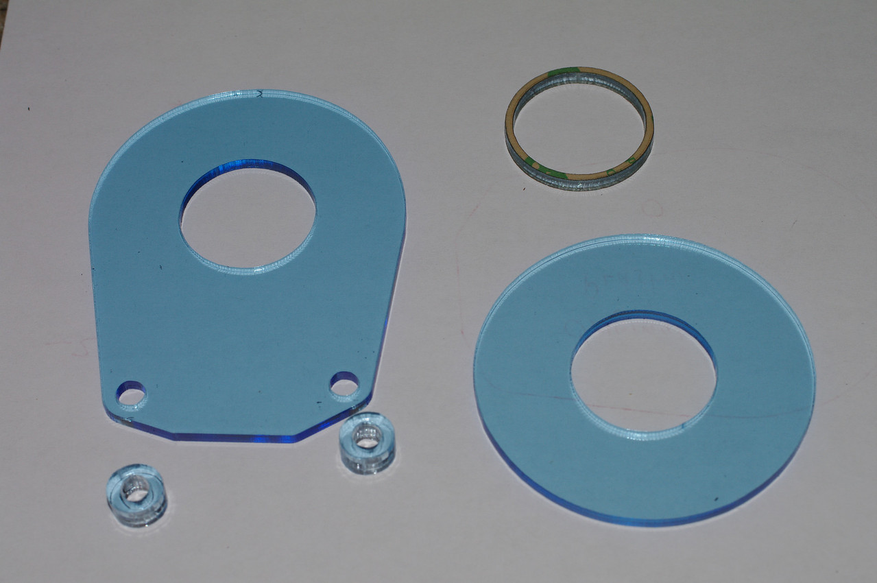 Peel all the parts, except the adhesive ring. Note the thick spacers.