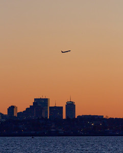 Plane taking off over Boston