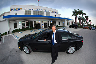 Commissioner Marc Sarnoff Poses with the new Ford Fusion in front of Miami City Hall for an ad in Ford magazine.