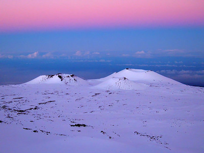 Snow-capped cinder cones as viewed at dusk from the summit of Mauna Kea. Big Island Hawaii, January 2009.