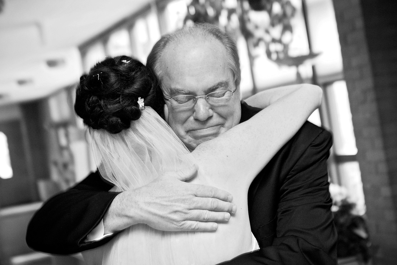 A hug from her dad before he walked her down the aisle