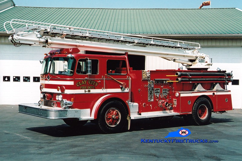 <center> RETIRED <br> Clay City  Ladder 22 <br> x-City of Wisconsin, WI  <br> 1970 International CO-8190/Ward LaFrance 1000/500/50' Telesqurt  <br> Greg Stapleton photo </center>