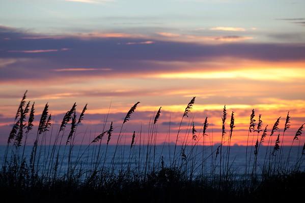 Sunset through the dunes