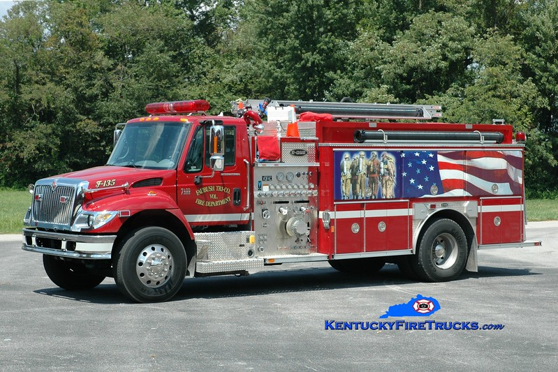 <center> Faubush Tri-County  Engine 135 <br> 2006 International 4400/E-One 1250/1500  <br> Greg Stapleton photo <br> </center>