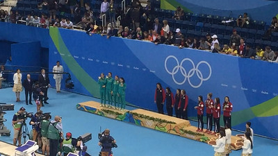 The USA Women's Relay team accepts their gold medals.