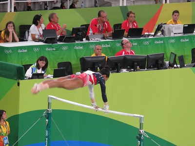 Gabby Douglas on the Uneven Bars