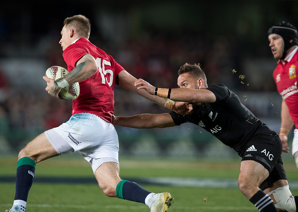 Aaron Cruden  tackles Liam Williams during game 7 of the British and Irish Lions 2017 Tour of New Zealand, the first Test match between  The All Blacks and British and Irish Lions, Eden Park, Auckland, Saturday 24th June 2017 (Photo by Kevin Booth Steve Haag Sports)  Images for social media must have consent from Steve Haag
