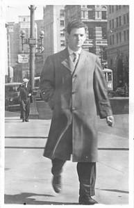 Dad walking down Main Street in Winnipeg