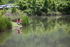 A mother and child near one of the salt-water ponds that dot the downtown area. With government support, Saltville today has built parks and added services, making it a pleasant place to raise a family or retire. Its days as a company town are just a memory.