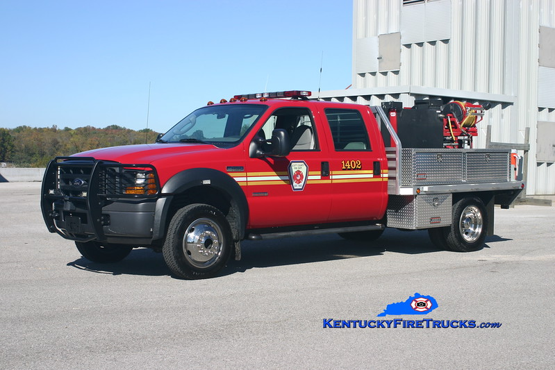 <center> Scott County  Brush 1402  <br> 2006 Ford F-550 4x4/Alumna-Mertz 250/250/10 <br> Kent Parrish photo </center>