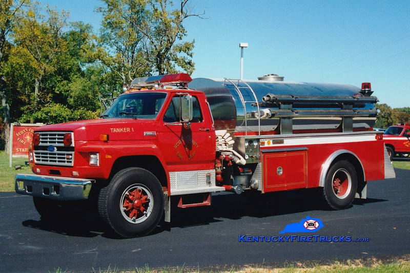 <center> RETIRED <br> Scott County  Tanker 1  <br> 1987 Ford F-800/4-Guys 400/1800 <br> Greg Stapleton photo </center>