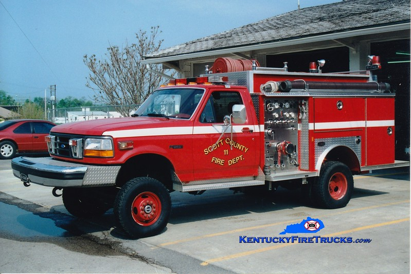<center> RETIRED <br> Scott County  Engine 11  <br> 1992 Ford F-450 4x4/E-One 450/300 <br> Greg Stapleton photo </center>