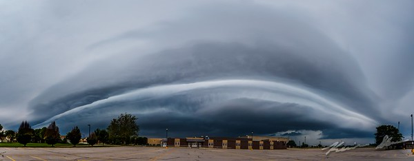 A shelf cloud looms out of the distance early in the morning