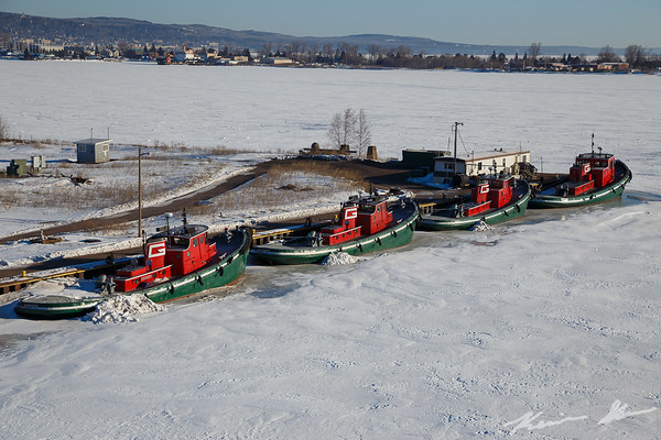 The G tugs at rest for the winter in their slip
