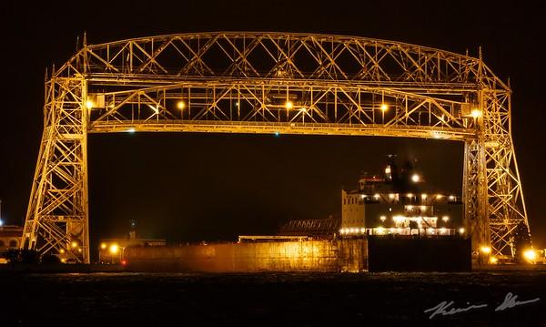 The Paul R. Tregurtha departs under a misty night sky