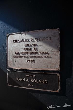 Name plates for the Wilson/John J. Boland under the unloading boom