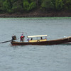 These longboats seem to be the best way to get about the islands.  The long propellar shaft allows them to skim into the shallow waters of lagoons and rivers.  Plus they're just damn cool.