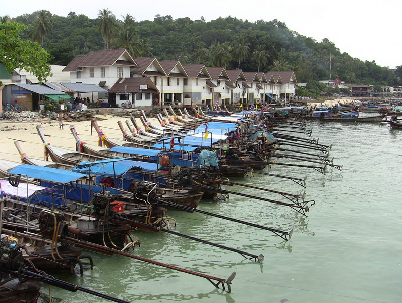 Longboats docked along Phi Phi Beach.