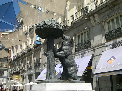 The statue of the bear eating from the strawberry tree in Puerta Del Sol - the symbol of modern Madrid