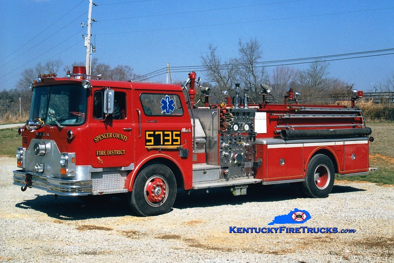 <center> RETIRED <br> Spencer County Engine 5735  <br> x-St Matthews, KY <br> 1976 Mack CF 1500/500  <br> Greg Stapleton photo </center>